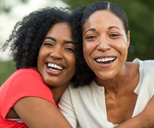 african american mother and daughter recovering from alzheimer's and dementia