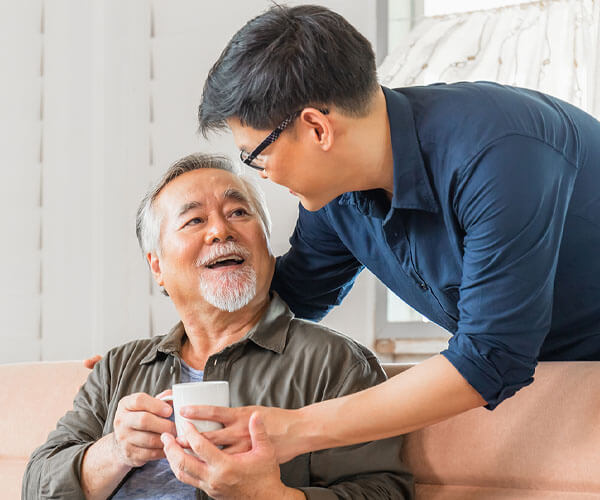 asian american father and son recovering from alzheimer's and dementia