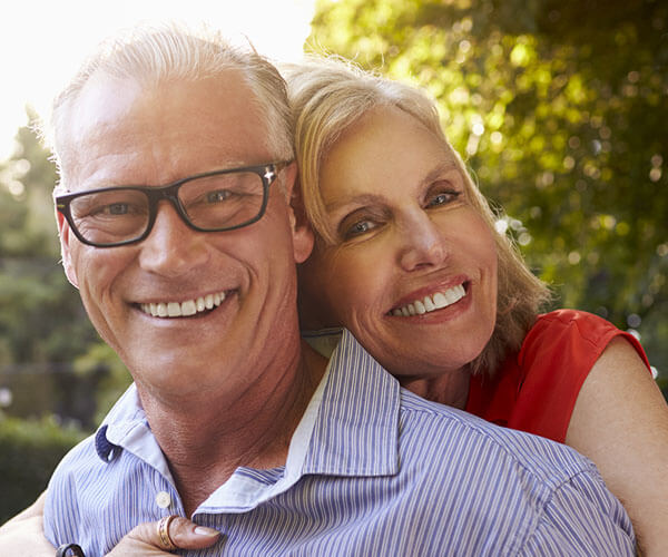 happy white couple middle aged recovering from alzheimer's and dementia