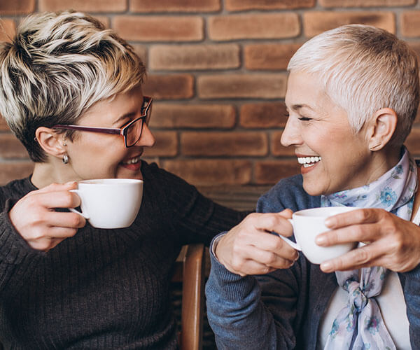 women having coffee recovering from alzheimer's and dementia